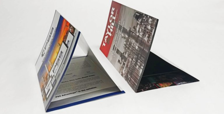 Double Gate Fold Brochure next to a Large Tri-Fold Brochure