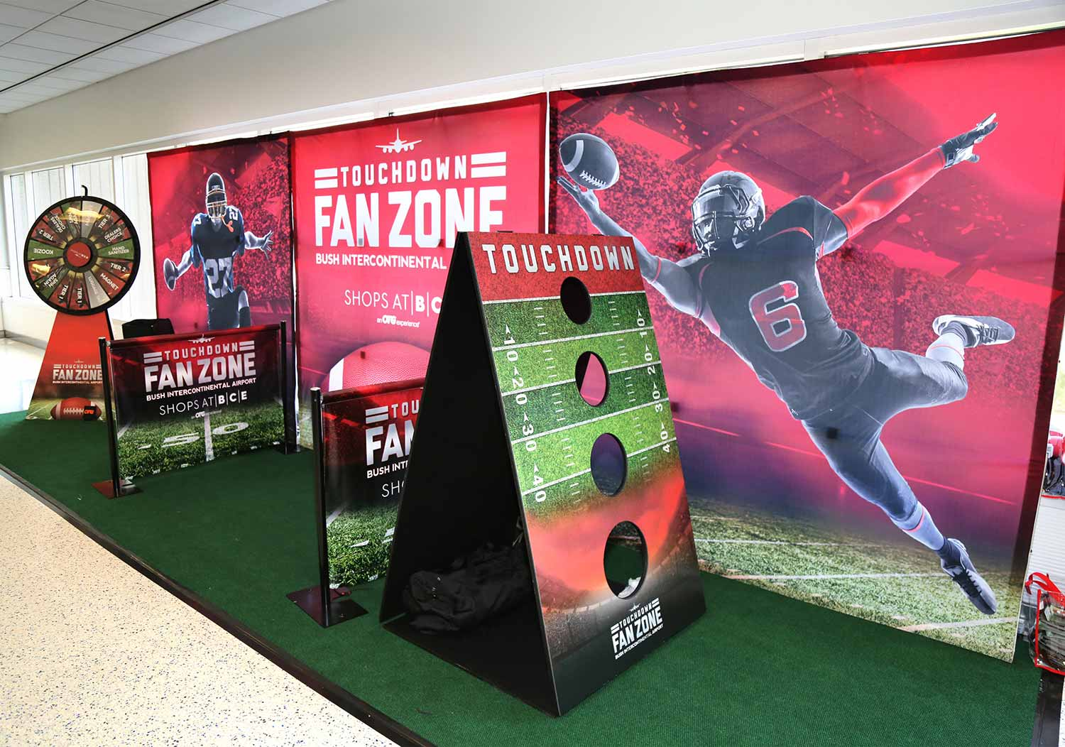 Design of booth and games for Super Bowl event in United Airlines terminals at IAH Houston, TX.