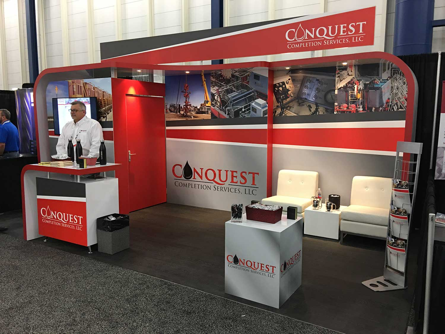 Trade show booth design, brochures, promotional items for Conquest at George Brown Convention Center.